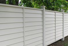 White Wooden fence with colonial posts