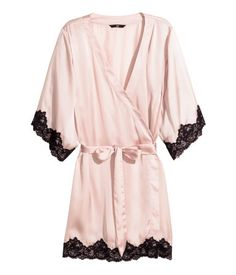 Short-sleeved kimono in satin with lace details, concealed tie at one side, and tie belt at waist.