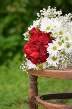 Red roses with daisy and gypsophila wedding bouquet