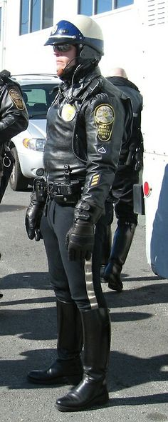 Police officer wearing protective clothing, such as a helmet