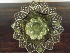 dish flower I made, fits over a 1/2 inch pvc pipe, has a glass shot glass glued to the back.