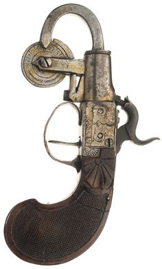 Origin unknown, appears English in design, with a measuring wheel incremented from 1 to 10, floral engraved frame, and a checkered bag shaped grip with floral acce