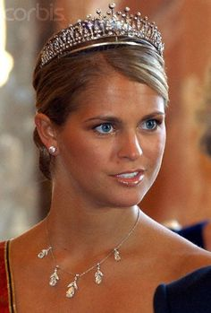 Madeleine is wearing the Modern Fringe Tiara and her necklace has pendants from the Connaught Loop Tiara.