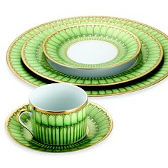 Bring an air of spring freshness to your table setting. Philippe Deshoulieres Arcades Dinnerware from the Limoges region in France has a bold and modern gold and green accent border that adds a touch of color to your tabletop.