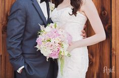 bride and groom portraits with pink and white bouquet