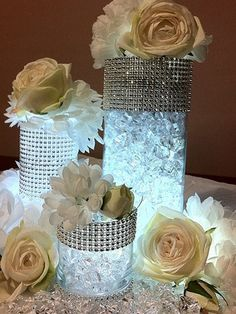 Clear cylinder vases with glass stones and submersible LED's make a creative centerpiece. Get the LED's at www.lumabase.com
