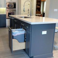 This fabulous kitchen island is a workhorse -- it features a dishwasher, sink with gooseneck faucet, sliding trash can and -- of course -- counter prep space. Adding a multitasking piece of furniture is a great way to get more out of a smaller kitchen.