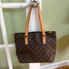 Authentic Louis Vuitton Cabas Alto Tote Authentic Louis Vuitton Cabas Alto tote.  This handbag is in EXCELLENT condition.  Brass hardware, tan leather trim, dual flat shoulder straps.  Includes duster bag.  As with all my handbags, it has ALWAYS been kept in its duster bag in a climate controlled closet.  The wallet is sold SEPARATELY.  I took pic of both items together, so that you could see what they look like together.  Additional pics upon request! Louis Vuitton Bags Totes