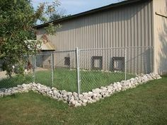 fenced dog play area around barn