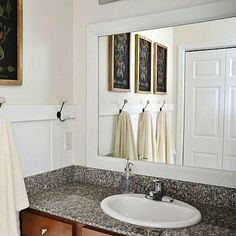 Easy and cheap bathroom upgrade. Frame your mirror to add that extra pop.