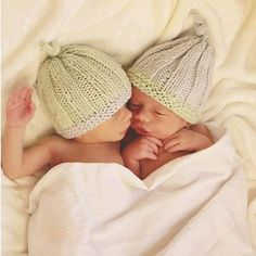 One of our customers, first-time grandmother of twin grandsons, knit these apply named Blue Sky Alpacas Baby's First Hat with Blue Sky Worsted Cotton. So sweet!