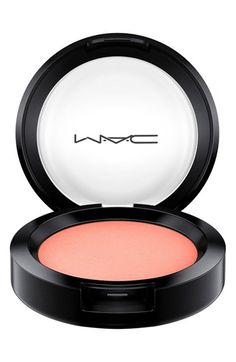 Obsessing over this gorgeous coral blush that perfectly defines the cheeks with shimmer.