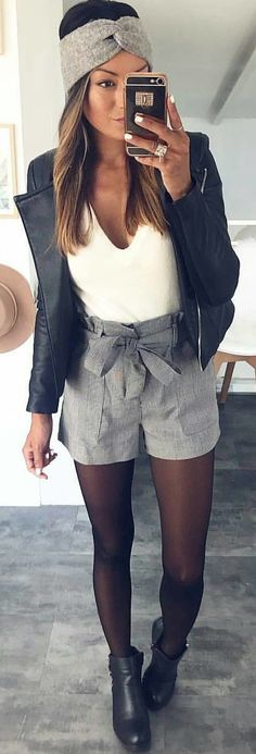 #winter #outfits  black leather blazer, white v-neck top and grey shorts