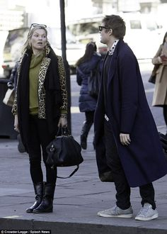 Back on: Kate Moss and Count Nikolai Von Bismarck put on a united front as they stepped out in West London on Friday