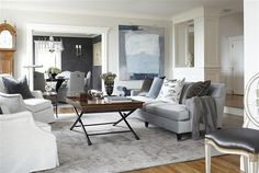 Pair grey decor with other calming hues, like blue, to transform your living room into a sophisticated oasis