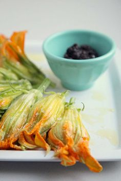 Burrata-Stuffed Squash Blossoms: Leave out olive tapenade and crostini, then can let guests assemble their own burrata-filled squash blossoms.