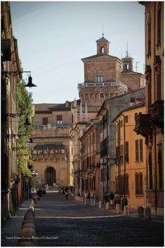 Via Ercole I D'Este in Ferrara (and a little view of towers Castle)