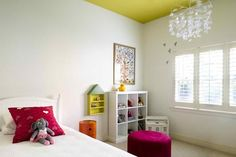 Chartreuse. The usual approach in children's bedrooms is to add loads of color with bright bedding, rugs and curtains … or if they're really lucky, a feature wall. A painted ceiling means the room is still bright and cheery, but you don't have to go overboard with color in the soft furnishings. A yellow with a hint of green in it will add an edge of sophistication to any room — just what a child's room needs if it's going to stand the test of time.