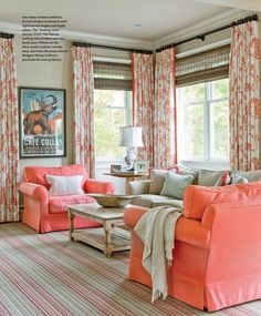 courtesy of house of turquoise. Aqua blue accents with coral/orange armchairs and curtains.