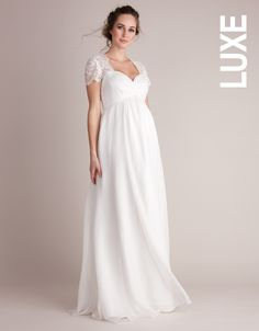 Unavailable sizes will be back in stock 17th of March    100% silk Lace shoulders  Empire waist Subtle stretch panel & keyhole back Side zipper for easy dressing   Look and feel sensational on your big day with our Ivory Silk & Lace Maternity Wedding Gown. Crafted in pure silk, the fully-lined style drapes beautifully over your curves then sweeps dramatically to the floor. A comfortable sweetheart bodice flatters your figure, and gives way to intricate lace and a stylish keyhole back,...