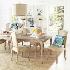 Stylist Tip – Lighting : Above a dining room table, 18 to 32 inches from the bottom of the fixture to the top of the table.