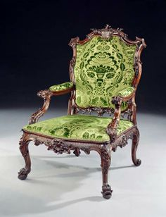 A GEORGE II CARVED MAHOGANY OPEN ARM CHAIR BEARING THE BARRINGTON ARMS, ATTRIBUTED TO JOHN LINNELL  1755