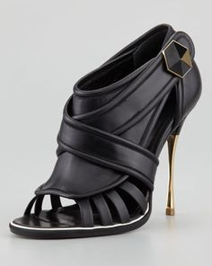 Nicholas Kirkwood golden heel cage bootie from fall 2013 collection. Click here to buy.