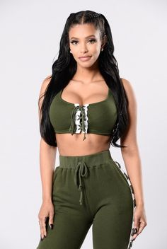 "- Available in Olive/White and Pink/White - Paired with ""Break A Sweat Pants"" - Sleeveless Crop Top - Crisscross Front Detail - 70% Cotton, 30% Polyester"