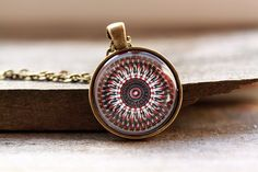 Nice looking sacred geometry necklace for people who like religious jewelry. Lovely 1 inch (25 mm) diameter spiritual amulet. Handmade mandala