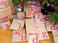 Creative Gift Wrap Ideas: children's initials on the wrap.