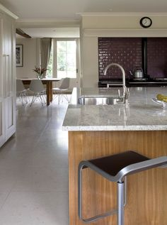Contemporary farmhouse kitchen design showing marble topped island with counter stool in foreground and Aga with metro tile surround in background. Metro Tiles, House Extensions, Cottage Design, Aga, Marble Top, Counter Stools, Georgian, Yorkshire, Kitchen Design