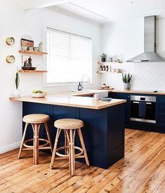Small kitchen with wood countertops, dark blue cabinets, and floating wood shelves and modern stainless steel vent hood Kitchen Room Design, Kitchen Layout, Home Decor Kitchen, Kitchen Living, Interior Design Kitchen, New Kitchen, Home Kitchens, Small Kitchen Diner, Very Small Kitchen Design