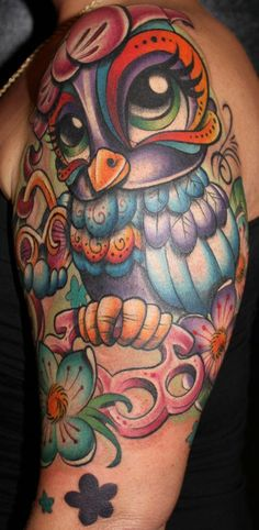 rockabilly style pretty owl tattoo. I'd never get it but it's adorable.
