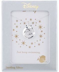 """Just Keep Swimming"" with this adorable Finding Dory round pendant necklace designed by Disney in sterling silver. Item comes presented on a lovely card. Approximate length: 18"". Approximate drop: 1""."