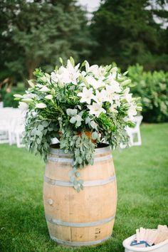 Rustic meets elegance with this barrel and lily combo: http://www.stylemepretty.com/little-black-book-blog/2014/10/24/romantic-morton-arboretum-wedding/ | Photography: Jacqui Cole - http://jacquicole.com/