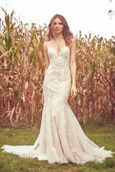 Feel like a real princess when you wear this beaded Venice lace fit and flare gown. When you walk down the aisle, your guests will notice the beautiful illusion cutout sides. The bikini neckline and scoop back complete the look.