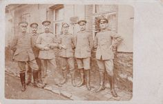 "WWI German NCOs. The sign behind them reads ""Feld-Gendarmerie Station."" Original Photo, Fritz die Spinne collection."