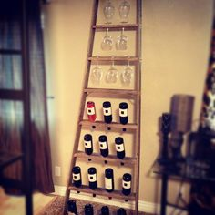 My husband came up with this idea when he found the ladder! He is so handy an creative! #wine #ladder #rack #diy