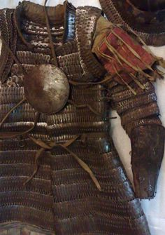 tibetan lamellar armour - love the use of fabric on the shoulders