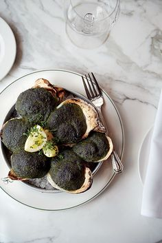 """The oysters Rockefeller at Galatoire's. Read about the New Orleans restaurant's famed Friday lunch line in """"A Tale of Two Kitchens"""" #gardenandgun (Photo by Christopher Testani)"""