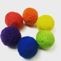 Rainbow felted dryer balls. I like to add geranium and lime essential oils to mine. What do you use?
