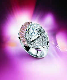 A vintage inspired design that features a pear shape diamond surrounded by white and pink diamonds. #michaelscreativejewelry #vintage