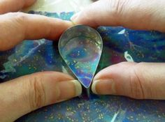 Use the cutter as a frame to select the desired section of the pattern for the cabochon