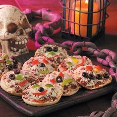 Monster Mini Pizzas ! mmmmm !!!  ( English muffins, pizza sauce, ground beef, mozzarella cheese & tomatoes, peppers and black olives for decorating).  :)