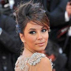Our favourite desperate housewife went for sexy smoky eyes, a bronze lip and a messy up 'do. #Cannes