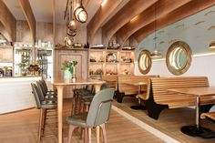 Hafen (Romanshorn, Switzerland), Europe Restaurant Susanne Fritz Architekten. simple natural interior, timber slat booth, timber arches on ceiling, seaside coast restaurant