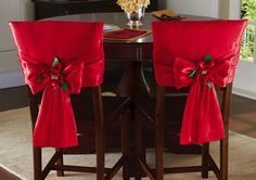 Red Holiday Bow Dining Chair Back Covers Set of 2 red dining chair back covers feature a satiny finish and Christmas poinsettia in the center of the bow Price 1499 Link Dinning Room Chair Covers, Red Dining Chairs, Chair Back Covers, Dining Chair Slipcovers, Chair Backs, Cafe Chairs, Upholstered Chairs, Chair Cushions, Ikea Chair
