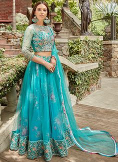 Simple Designer pine green color lehenga choli for bridal look.For order WhatsApp on draping styles dress for bride indian dresses indian teens wedding outfits sisters blouse designs indian with dress blouse designs dresses indian Lehnga Dress, Lehenga Blouse, Bridal Lehenga Choli, Indian Lehenga, Floral Lehenga, Blue Lehenga, Lehenga Style, Blouse Dress, Pakistani Dresses