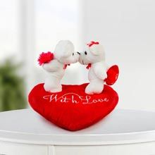 Love is all We need Tell your partner that you both complete each other. These two teddies, one holding flower and other holding heart in their hands and standing on a heart shaped cushion. #giftforwife