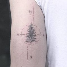Pine tree compass tattoo on the back of the left arm. Tattoo Artist: Lindsay April